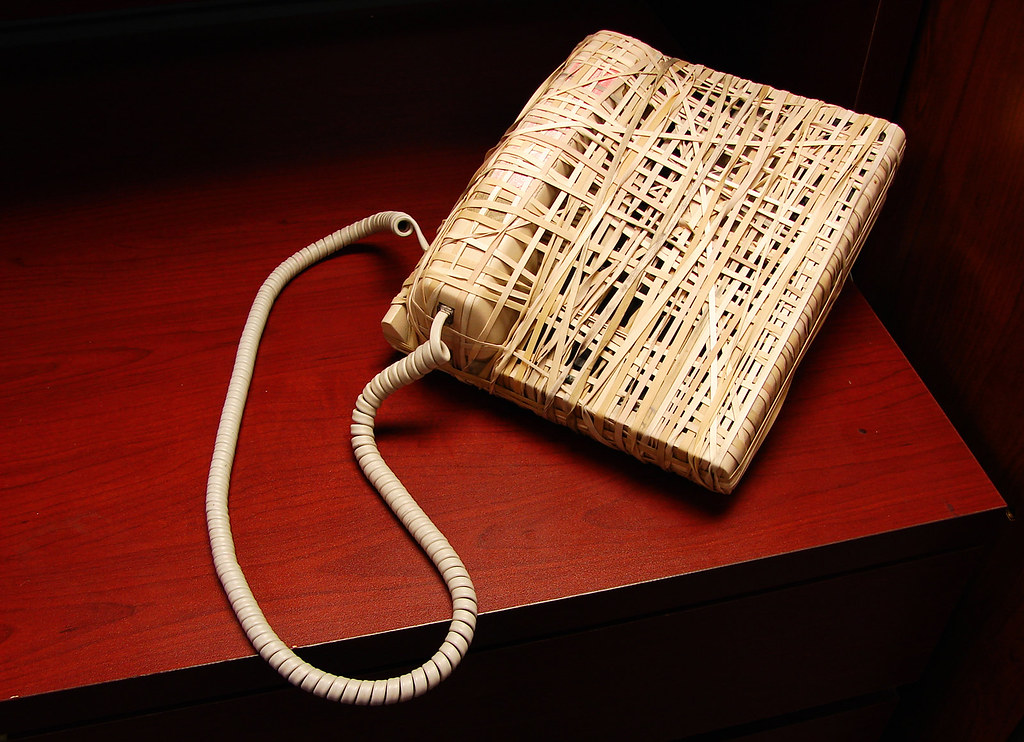 desk phone wrapped in elastic bands